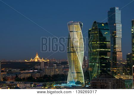 MOSCOW - JUN 13, 2016: Modern Moscow International Business Center at summer evening and MSU. Years of construction of complex - 1995-2018