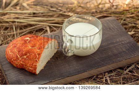Bread And Milk Cup On Wooden Board