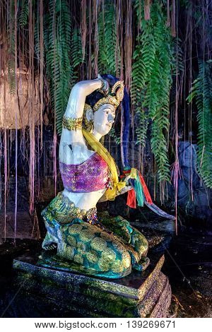Garden at the temple of the Golden Mount is decorated with religious statues Bangkok Thailand. Soft focus.