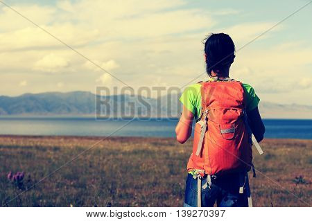 one young woman backpacker enjoy the view
