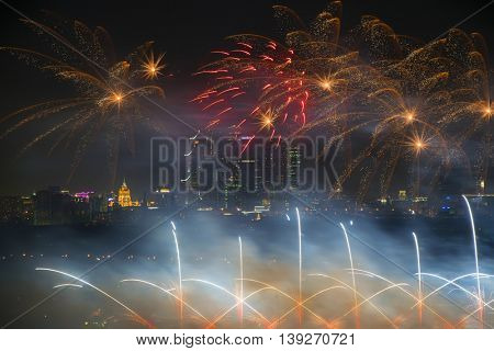 Big beautiful fireworks and skyscrapers at night in Moscow, Russia