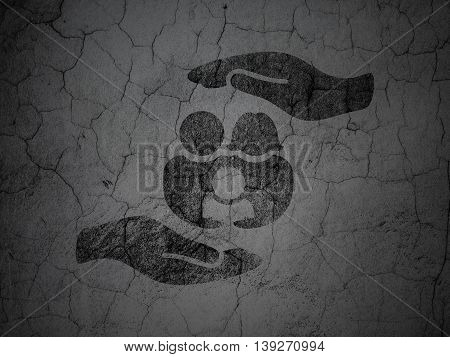 Insurance concept: Black Family And Palm on grunge textured concrete wall background