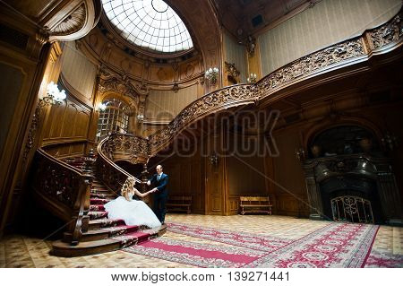 Elegant Wedding Couple At Old Vintage House And Palace With Big Wooden Stairs