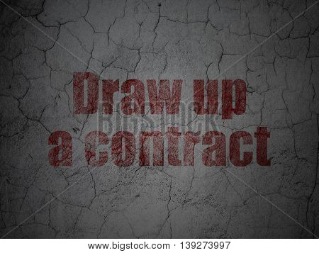 Law concept: Red Draw up A contract on grunge textured concrete wall background