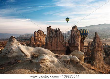 Balloons in the mountains of Cappadocia in the morning autumn