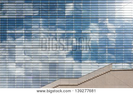 Modern Office Building Glass Facade With Sky Reflection