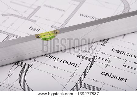 Bubble level, measuring tool, construction of the building layout, building drawing on paper, quality control of construction works