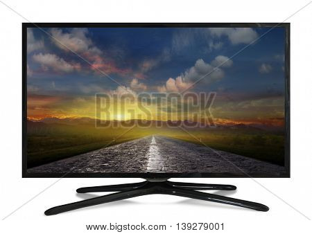 4k monitor with a picture on the screen: The road is paved at sunset