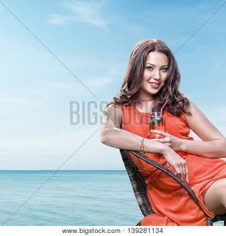 Young Woman In Seaside Cafe
