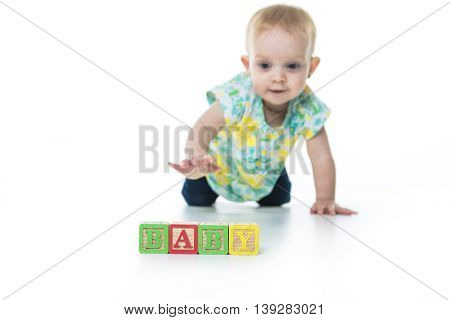 A Happy kid playing toy blocks  isolated on white background