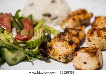Turkish Traditional Skewer Chicken Kebab served with rice and vegetables