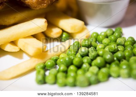 Peas and chips, traditional british food side dish