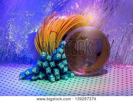 earth globe against fiber optic background