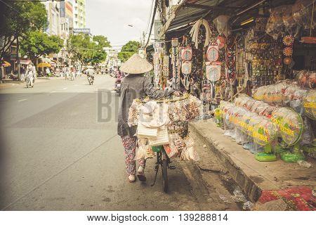 SAIGON VIETNAM JUNE 26 2016: Food on Street. The Vietnamese vendor