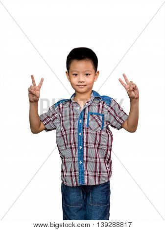 Portrait of happy little boy showing fingers or victory gesture two hands white background