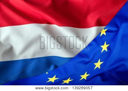 Flags of the Netherlands and the European Union. Netherlands Flag and EU Flag. World flag money concept.
