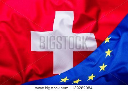 Flags of the switzerland and the European Union. Switzerland Flag and EU Flag. World flag money concept.
