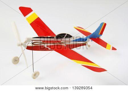 Toy model plane on plain background