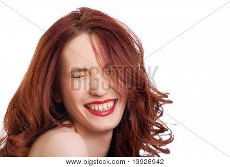 attractive smiling woman squint eyes on white background