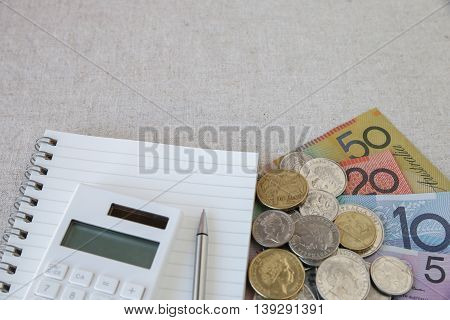 Australian money AUD with calculator notebook selective focus copy space background