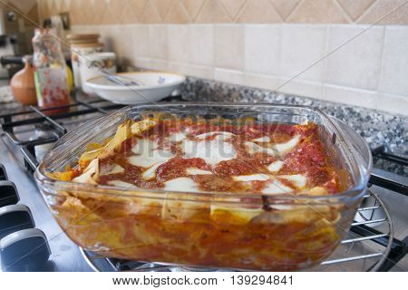 bolognese lasagne with bechamel sauce in a glass bowl