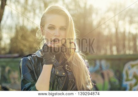 portrait of sexy blonde woman stylish sunglasses long hairs perfect skin sunny day black leather jacket