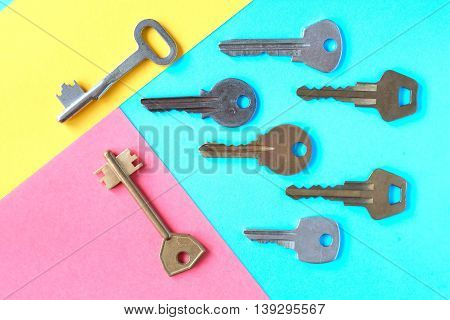 Abstract composition with door keys on color paper background