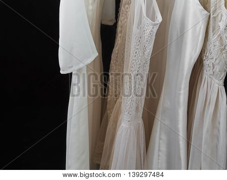 womens clothing on a hanger, underwear, womens dresses on black background