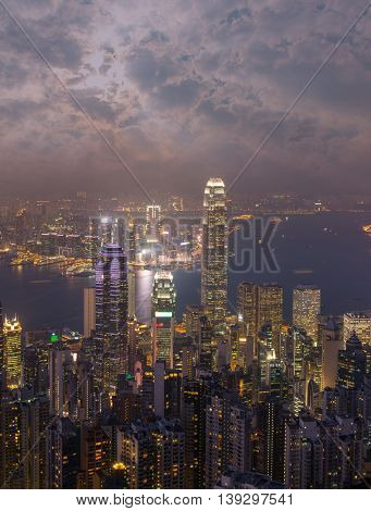 Hong Kong city skyline panorama at night with Victoria Harbor and skyscrapers