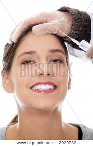 Plastic surgeons giving injection in female skin. Isolated on white