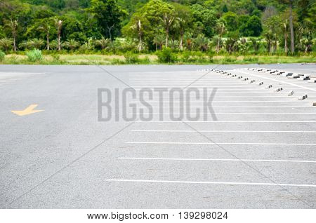 The Outdoor Car Parking Lot With White Color Marking