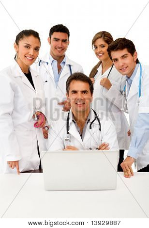 Group of doctors with a laptop ? isolated over white