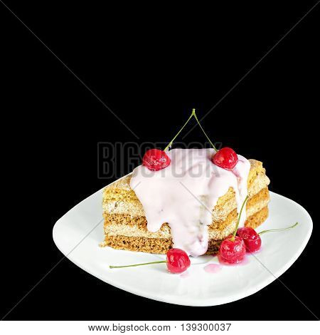 Piece of cake with cherries and yogurt on a plate, isolated on black background
