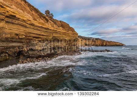 View of cliffs and beach at high tide, Sunset Cliffs, San Diego, California.