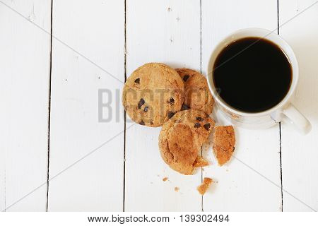 Cookies and coffee on white wooden palette