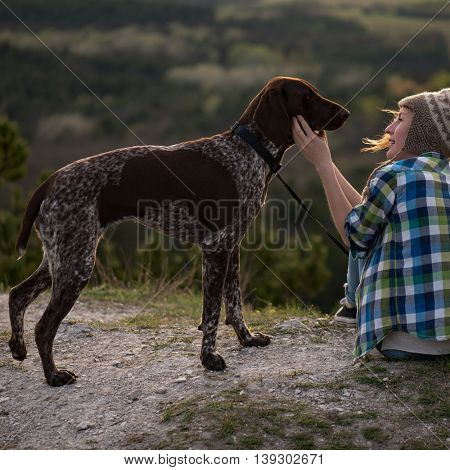 German pointer dog and young woman outdoor