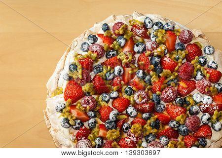 closeup of Pavlova dessert on wooden table