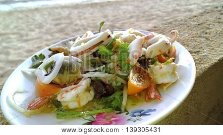 Spicy seafood salad have Sea Beach landscape nature