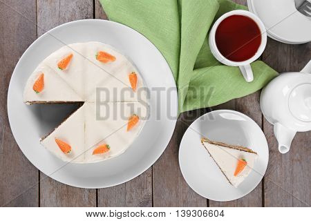 Delicious carrot cake with tea, top view