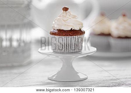 Tasty cupcake on stand