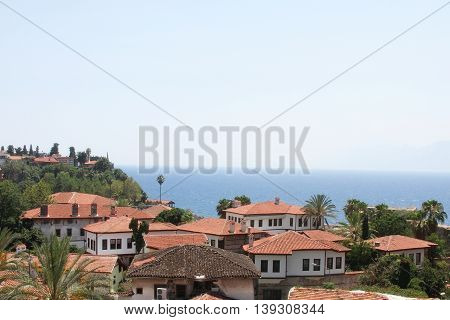 Red roofs of the city on the sea and the sky