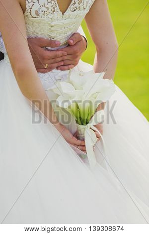 Bride and groom with white wedding bouquet