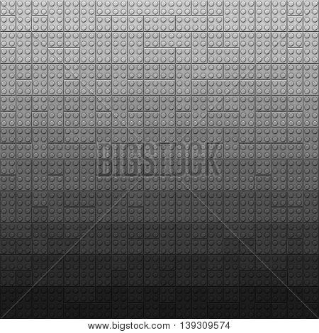 Plastic construction bricks background in dark gray colors