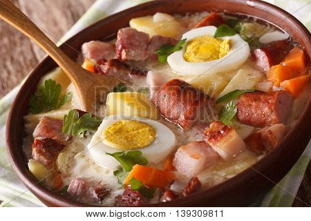 Polish Zurek Soup With Vegetables, Sausage And Eggs In A Bowl Macro, Horizontal