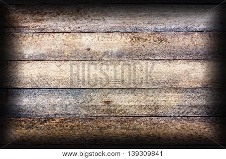 old wooden texture grunge background with horizontal boards granary. toned photo with vignette frame