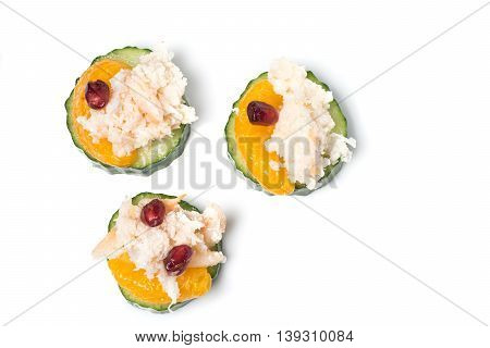 Crab meat Appetizer served on Cucumber slices isolated on white