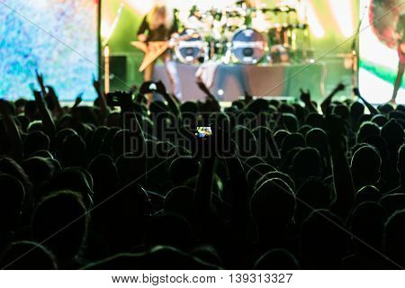 crowd of people at a concert dark silhouettes