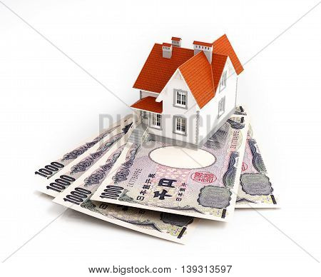 Japanese yen banknotes under house. 3d illustration.