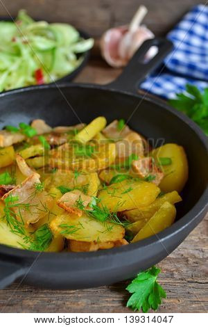 fried potatoes with bacon and green onions in a cast iron skillet