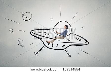 Girl flying in spaceship . Mixed media